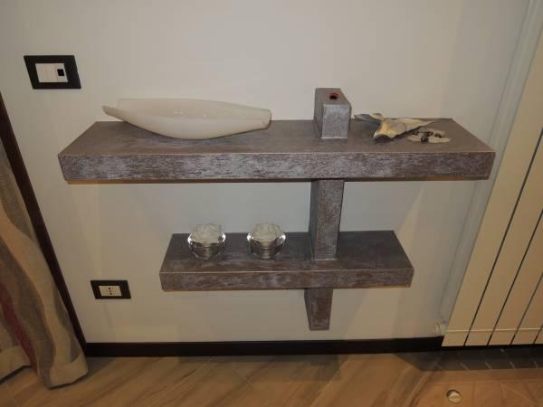 Opere in cartongesso e controsoffitti for Mensole angolari per bagno